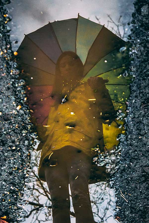 Women Reflection in Puddle